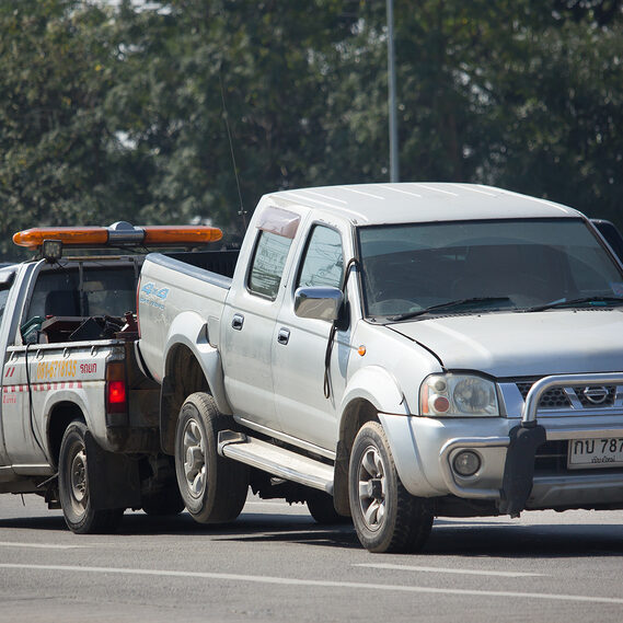 car being towed in the road