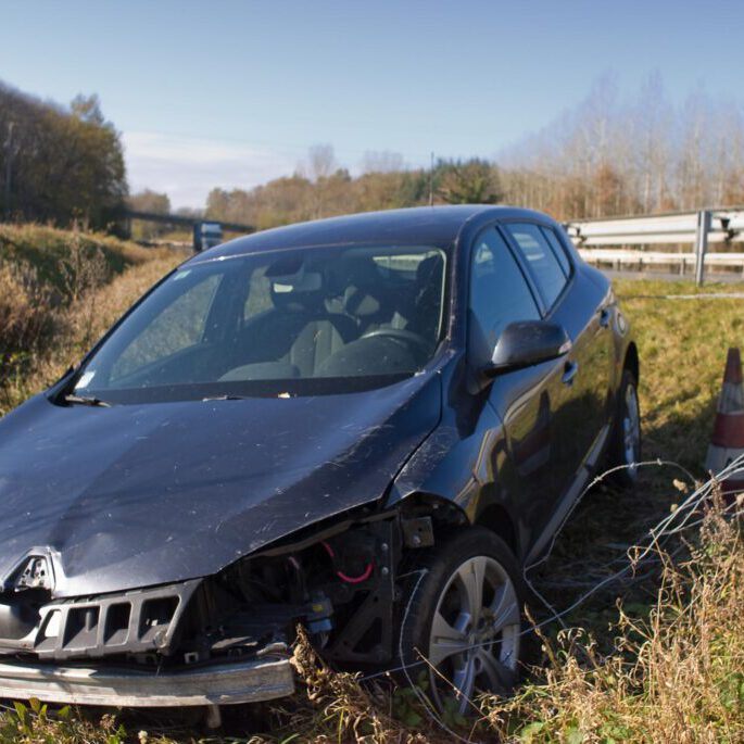 crashed car beside the road