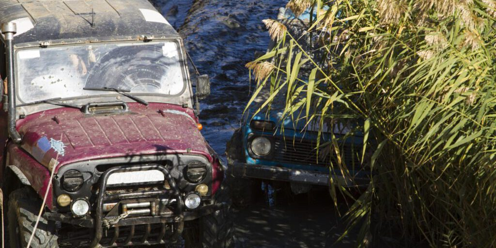 two automobile in the mud